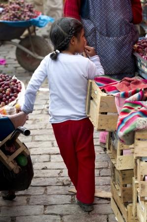 Girl standing at a market, Cuzco, Peru Stock Photo - 17227876