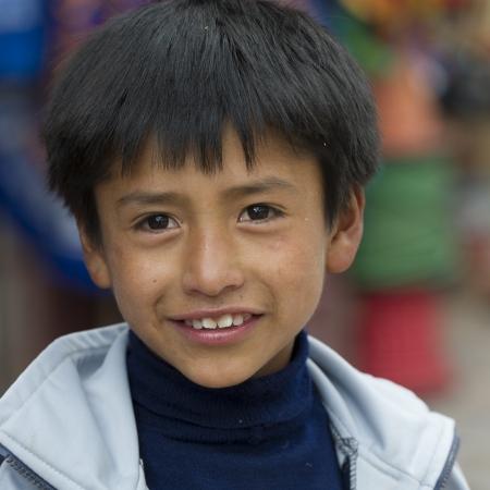 satisfies: Portrait of a boy smiling, Cuzco, Peru