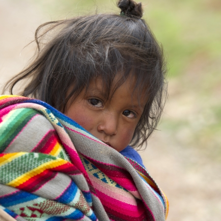Portrait of a girl with tousled hair, Sacred Valley, Cusco Region, Peru