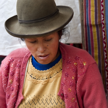 south american ethnicity: Close-up of a woman at Sunday market, Pisac, Cuzco, Peru Editorial