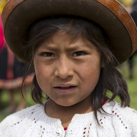 Portrait of a Quechua Indian girl at Chumpepoke Primary School, Poques, Sacred Valley, Cusco Region, Peru