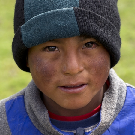 Portrait of a Quechua Indian boy at Chumpepoke Primary School, Poques, Sacred Valley, Cusco Region, Peru Stock Photo - 17227815