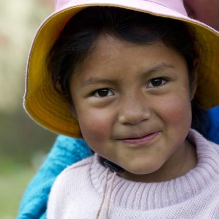 peru: Portrait of a Quechua Indian girl at Chumpepoke Primary School, Poques, Sacred Valley, Cusco Region, Peru