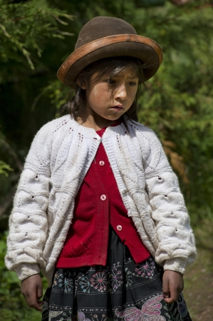 quechua: Close-up of a Quechua Indian girl at Chumpepoke Primary School, Poques, Sacred Valley, Cusco Region, Peru