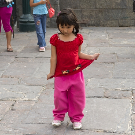 Close-up of a girl pulling her top, Historic Centre of Lima, Lima, Peru