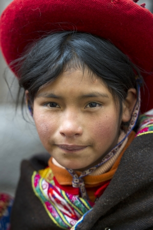 Portrait of a girl wearing a hat, Sacred Valley, Cusco Region, Peru