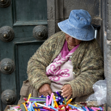 Woman selling candles at a market stall, Cuzco, Peru Stock Photo - 17175914