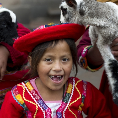 Portrait of a Quechua Indian girl with kid goats, Cuzco, Peru