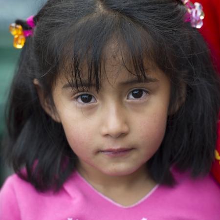 quechua: Portrait of a Quechua Indian girl, Plaza Regocijo, Cuzco, Peru