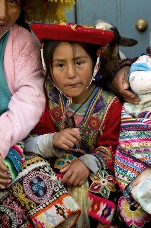 bonnet up: Portrait of a girl in traditional clothing, Cuzco, Peru