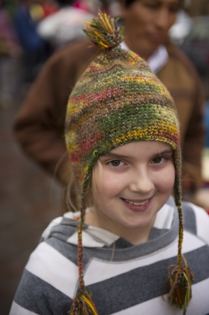 cusco province: Portrait of a girl wearing a bobble hat, Plaza Regocijo, Cuzco, Peru