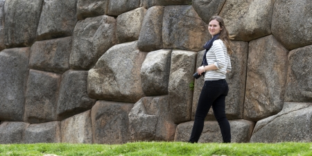 Woman photographing at old ruins, Sacsayhuaman, Sacred Valley, Cusco Region, Peru