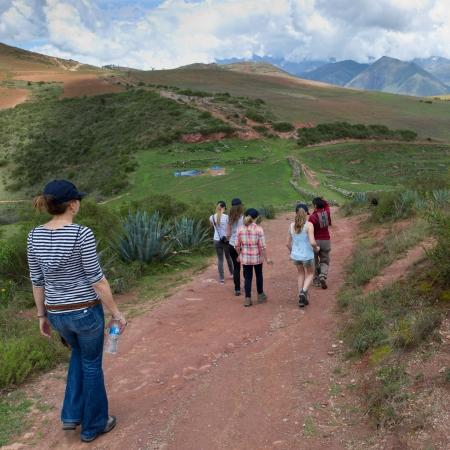 levit: Group of people walking towards Incan agricultural terraces, Moray, Machu Picchu, Cusco Region, Peru