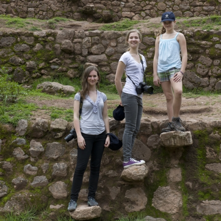 Friends standing on steps at Incan terraces, Moray, Machu Picchu, Cusco Region, Peru