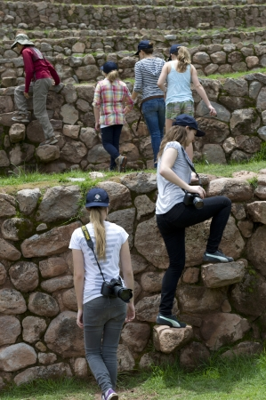 Tourists at Incan terraces, Moray, Machu Picchu, Cusco Region, Peru