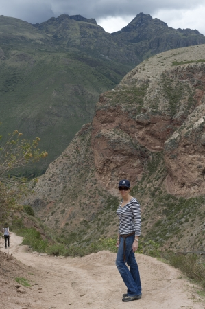 full disclosure: Woman standing on the road in Sacred Valley, Cusco Region, Peru
