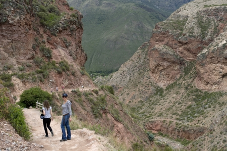 Women standing on the road in Sacred Valley, Cusco Region, Peru