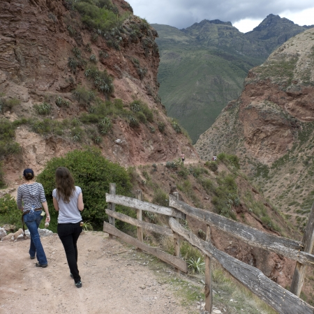 Women walking on the road in Sacred Valley, Cusco Region, Peru photo
