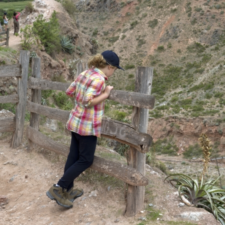 full disclosure: Girl looking at valley view in Sacred Valley, Cusco Region, Peru Stock Photo