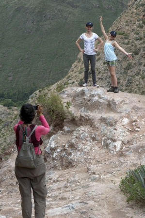 full disclosure: Woman taking picture of her friends with a camera in Sacred Valley, Cusco Region, Peru Editorial