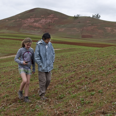 Teenage girl with her friend walking in Sacred Valley, Cusco Region, Peru