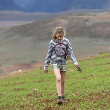 Teenage girl walking in a field, Sacred Valley, Cusco Region, Peru Stock Photo - 17227807