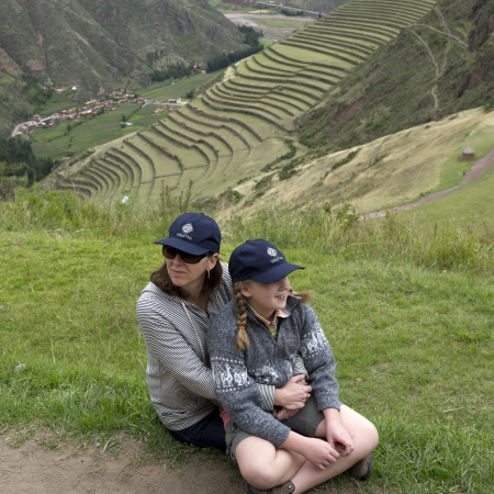 cusco region: Woman relaxing with her daughter at Archaeological Park of Pisac, Pisac, Sacred Valley, Cusco Region, Peru Editorial