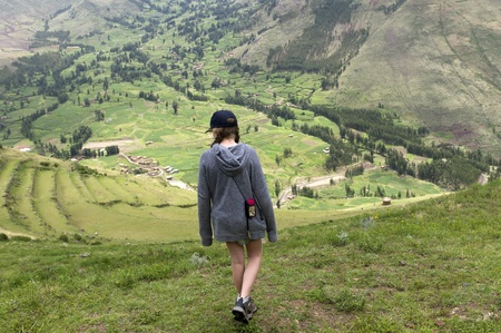 full disclosure: Teenage girl at Archaeological Park of Pisac, Pisac, Sacred Valley, Cusco Region, Peru Editorial