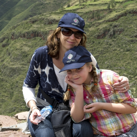 Woman relaxing with her daughter at Archaeological Park of Pisac, Pisac, Sacred Valley, Cusco Region, Peru