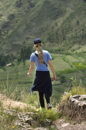 Teenage girl at Archaeological Park of Pisac, Pisac, Sacred Valley, Cusco Region, Peru