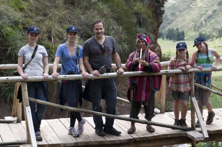 full disclosure: Man with his family on a footbridge at Archaeological Park of Pisac, Pisac, Sacred Valley, Cusco Region, Peru