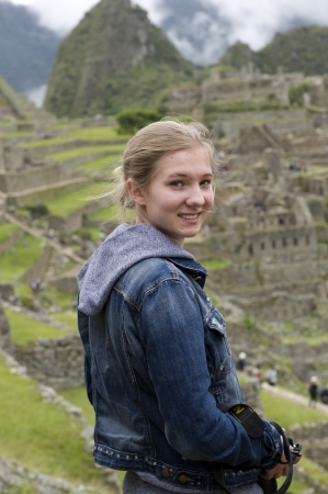 Teenage girl at The Lost City of The Incas, Machu Picchu, Cusco Region, Peru