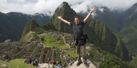 full disclosure: Man with his arm outstretched at The Lost City of The Incas, Machu Picchu, Cusco Region, Peru Editorial