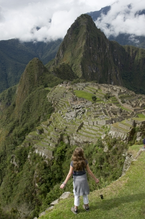 full disclosure: Rear view of a girl looking at The Lost City of The Incas, Machu Picchu, Cusco Region, Peru