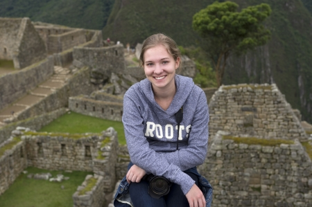 Teenage girl at The Lost City of The Incas, Machu Picchu, Cusco Region, Peru Stock Photo - 17227841