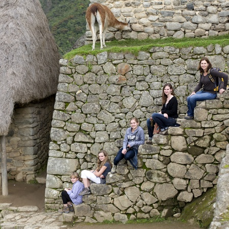 the lost city of the incas: Friends sitting on a staircase at The Lost City of The Incas, Machu Picchu, Cusco Region, Peru Editorial