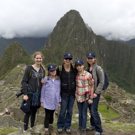 Portrait of a family with The Lost City of The Incas in the background, Machu Picchu, Cusco Region, Peru