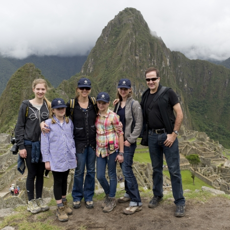 full disclosure: Portrait of a family with The Lost City of The Incas in the background, Machu Picchu, Cusco Region, Peru