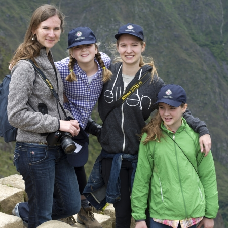 satisfies: Portrait of a woman with her sisters at The Lost City of The Incas, Machu Picchu, Cusco Region, Peru