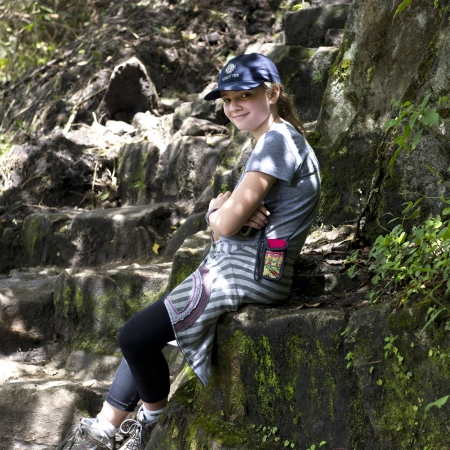 full disclosure: Teenage girl sitting on steps at The Lost City of The Incas, Machu Picchu, Cusco Region, Peru