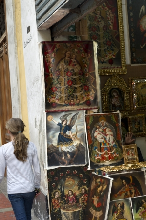 Rear view of a girl walking in front of a paintings store, Historic Centre of Lima, Lima, Peru