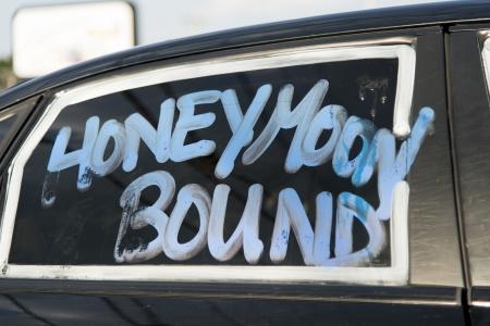 western script: Honeymoon Bound text on a car window, Branson, Taney County, Missouri, USA