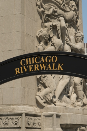Chicago Riverwalk sign and Statues on Michigan Avenue Bridge, Chicago, Cook County, Illinois, USA photo