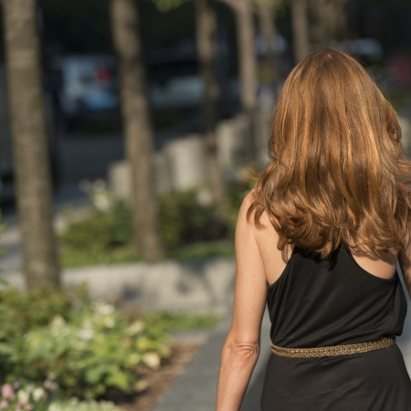 waistup: Rear view of a woman walking, Chicago, Cook County, Illinois, USA Stock Photo
