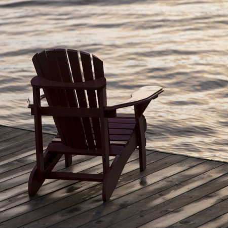 adirondack chair: Adirondack chair on a dock at the Lake of The Woods, Ontario, Canada