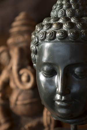 Close-up of Buddha statue, Lake of The Woods, Keewatin, Ontario, Canada photo