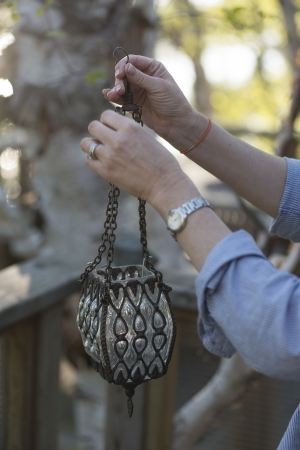 showpiece: Person holding a lantern, Lake of The Woods, Keewatin, Ontario, Canada