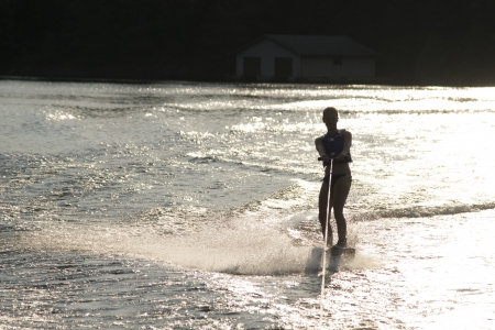 wakeboarding: Woman waterskiing at Lake of The Woods, Keewatin, Ontario, Canada Stock Photo