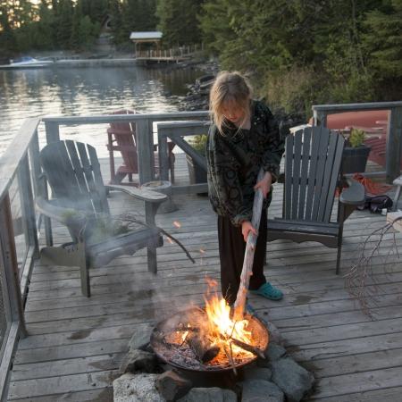 adirondack chair: Girl enjoying a campfire, Lake of The Woods, Keewatin, Ontario, Canada