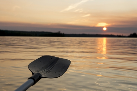 oar: Oar in the lake at sunset, Lake of The Woods, Keewatin, Ontario, Canada Stock Photo